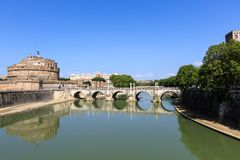 Attraction Saint Angel Castle, pedestrian bridge across Tiber Ponte Sant Angelo. Attraction Saint Angel Castle and bridge Ponte Sant Angelo in Rome, Italy, Sunny Royalty Free Stock Images