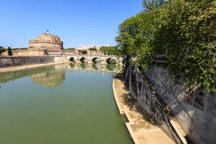 Attraction Saint Angel Castle, pedestrian bridge across Tiber Ponte Sant Angelo. Attraction Saint Angel Castle and bridge Ponte Sant Angelo in Rome, Italy, Sunny Stock Photography