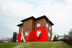 Attraction Upside Down House. Rostov - on - Don, Russia - August 13, 2015: Attraction Upside Down House  in the Russian Exhibition Center Royalty Free Stock Photo