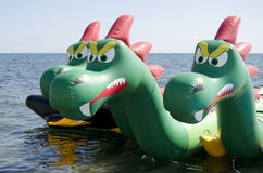 Attraction on the water in the form of a dragon Stock Photography