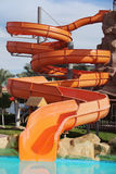 Attraction with a water pipe in the aqua park. Colorful water park tubes and a swimming pool Stock Image