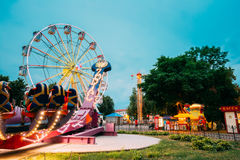 Attraction Zodiac With People Going Start. Ferris Wheel Evening. Gomel, Belarus - July 17, 2016: The Attraction Feature Zodiac With People On Seats Going To royalty free stock images