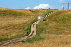 Attraction zorbing ball rolling downhill inside an orb Royalty Free Stock Photos
