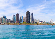 Attractions of Chicago. Chicago, USA - May 24, 2014: The Chicago skyline and part of Navy Pier seen from Lake Michigan Royalty Free Stock Photos