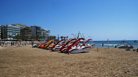 Attractions on the sandy beach Stock Images