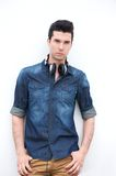 Attractitve male fashion model standing with headphones Stock Photography
