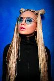 Attractiva younge  blonde woman with  african braids in black pullover Royalty Free Stock Images