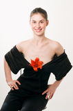 Attractive. Young adult woman posing with flowers on her decolletage Stock Images