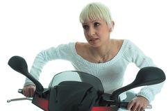Attractive. Blond girl drive motor Stock Photo