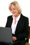 Attractive 40 Something woman with Laptop Royalty Free Stock Photos