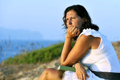Free Attractive 40s Mature Woman With Book Looking Horizon Pensive Royalty Free Stock Photo - 43511435