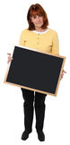 Attractive 57 Year Old Teacher with Chalkboard. Attractive 57 year old teacher with blank chalkboard over white Royalty Free Stock Photo