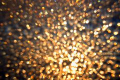 Attractive abstract shining background. With blured bokeh lights Stock Photos