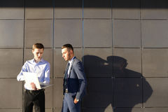 Attractive active young male man, businessman, student holds lap. Handsome confident young male man, businessman, student holds laptop in hands and deliver Stock Images