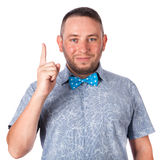 Attractive adult man with beard in a blue bow tie in summer shirt on an isolated Stock Image