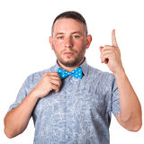 Attractive adult man with beard in a blue bow tie in summer shirt shows the gesture with hands Stock Photo