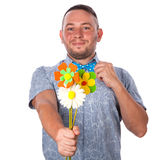 Attractive adult man with stubble in a bow tie in summer shirt holding a bouquet of flowers Stock Images