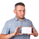 Attractive adult man with stubble in summer shirt in his hands holding a white sheet Royalty Free Stock Images