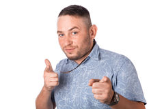Attractive adult man with stubble in summer shirt shows a finger in your face Royalty Free Stock Photo