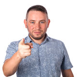 Attractive adult man with stubble in summer shirt shows a finger in your face Stock Images