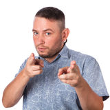 Attractive adult man with stubble in summer shirt shows a finger in your face on an isolated Stock Photo