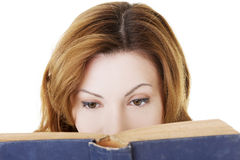 Attractive adult woman with book Stock Photography