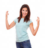 Attractive adult woman crossing her fingers Stock Photo