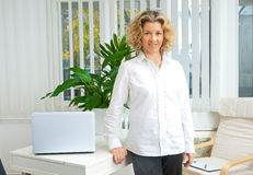 Attractive adult woman in her office Stock Image