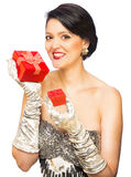 Attractive adult woman holding red present Royalty Free Stock Images