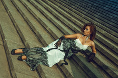 Attractive adult woman lying on stairs Stock Images