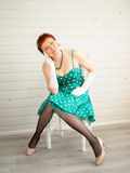 Attractive adult woman sitting on chair Stock Photography