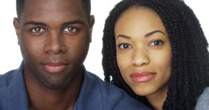 Attractive African American couple in front of white background Royalty Free Stock Photos