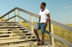 Attractive african american male smiling outdoors Royalty Free Stock Photos