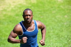 Attractive african american man running outside Stock Image