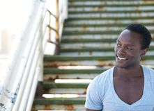 Attractive african american man smiling outdoors Stock Photos
