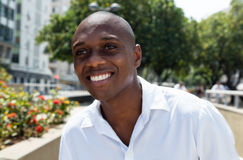 Attractive african american man in white shirt outdoor Stock Image