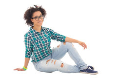Attractive african american teenage girl sitting isolated on whi Stock Image