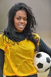 Attractive African American woman football (soccer) player Royalty Free Stock Image