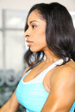 Attractive African American Woman In Gym. Close up pretty african american woman training or exercising in gym Stock Photo