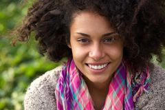 Attractive african american woman smiling outdoors Stock Image