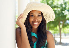 Attractive african american woman smiling with sun hat Royalty Free Stock Images