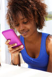 Attractive african american woman using mobile phone Royalty Free Stock Images