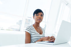 Attractive african american young woman accountant working in office Stock Photos