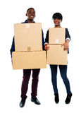 Attractive african couple holding cardboard boxes Royalty Free Stock Images