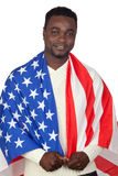 Attractive african man with a American flag Royalty Free Stock Photos