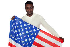 Attractive african man with a American flag Royalty Free Stock Image
