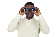 Attractive african man looking through binoculars Royalty Free Stock Image
