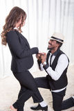 Attractive african man is making a wedding proposal. Attractive african men is making a wedding proposal Royalty Free Stock Image