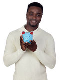 Attractive african man with a a moneybox Stock Images