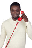 Attractive african man with a red phone Royalty Free Stock Images